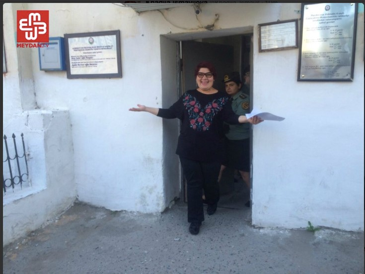 Khadija Ismayilova walks free after a year and a half in detention. Photo credit - Meydan.tv